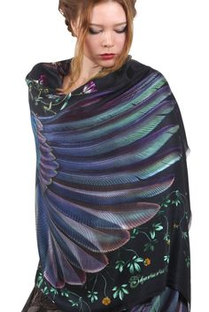 Wrap yourself in beauty with this gorgeous scarf. It is 100% silk and hand painted.