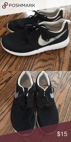 Kids 6Y Nike shoes Black Nikes with silver swoosh. Plenty of wear left but they've been worn a lot!  Boys or girls! Nike Shoes Sneakers