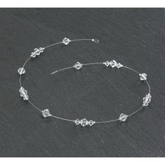 Bijou de cheveux ALICIA.  Bijou de cheveux « lasso » sur fil nylon transparent, composé de perles en cristal Swarovski de couleur crystal.