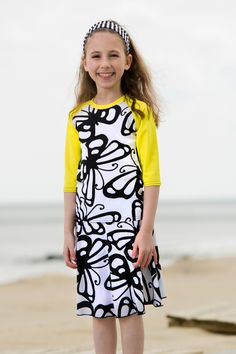 This is our Yellow Butterfly Swim Set for girls. It's part of our FLAIR line- with a beautiful flairy skirt that allows kids to be active and modest. Made of bathing suit material that dries extra quickly!