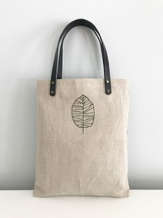 120393a1cb7a Raw linen tote bag with green embroidered birch leaf. Available from  berrycoast.com