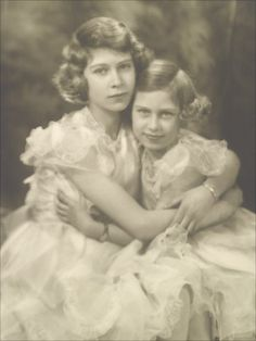 This shot of princesses Elizabeth and Margaret was taken just months before the outbreak of World War II in 1939. It is the last picture to show the princesses wearing frilly dresses and pretty necklaces. by Marcus Adams