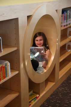 Girl reading in a round nook.  (She seems a bit old for a picture book, though.... Odd.)