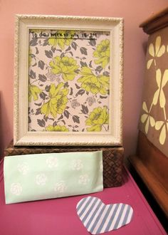 picture frame whiteboard, painted canvas marker pocket, and heart-shaped scrap fabric eraser.