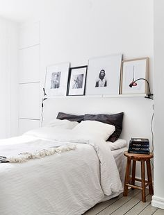 Love the shelf above the bed for art and clamped lamps!