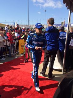 Ricky @StenhouseJr and @DanicaPatrick make their way into the drives meeting tent
