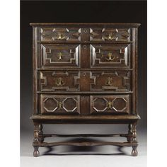 A CHEST OF DRAWERS, CHARLES II, LATE 17TH CENTURY oak, with four long drawers and panelled sides, on a 19th century oak stand