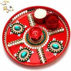 A beautiful steel based artistically hand painted red thali adorned with kundan beads making it ideal for gifting.This has an option of sending kaju katli mithai with it.http://www.exoticabazaar.com/view/9160-68-red-pooja-thali-with-500-gms-kaju-katli.html