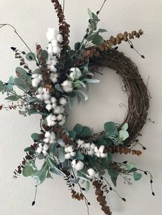 Come home to this beautiful wreath that looks good at any angle! A mixture of brown eucalyptus stems and leaves plus stems of navy pussy willow and cotton and lambs ear #cottonwreath #eucalyptuswreath #springwreath #summerwreath  #wickiwreaths #southernwreath