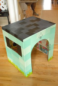 Life as a Thrifter: Our Make-Shift Playhouse ... I love what she did with this cardboard box