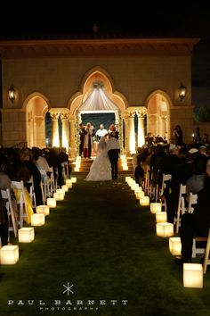 Beautiful candle lit wedding aisle at the Grand Del Mar. Evening ceremonies can be very romantic with the right atmosphere!