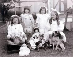 Wonderful group of Victorian girls with dolls, teddy bear and a pet dog. Australia, 1906.
