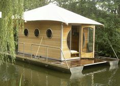 If you want to enjoy your own single live, you can choose these tiny prefab homes.They can make these tiny prefab homes for both of them.You are allowed to install thee wheels under your tiny prefab home. Tiny Boat, Shanty Boat, Architecture Design, Sustainable Architecture, Residential Architecture, Contemporary Architecture, Houses In France, Best Tiny House, Floating House