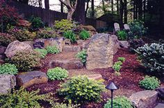 Boulders can be both functional and decorative, as seen in this photo. Landscaping With Boulders, Garden Landscaping, Boulder Landscape, Dream Garden, Home And Garden, Outdoor Spaces, Outdoor Decor, Green Earth, Unique Gardens