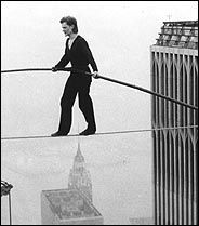 august 7, philippe petit walks tightrope between the twin towers in 1974