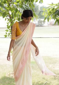 An easy breezy crepe saree with a cascade fall at the pallu and embroidered along the border
