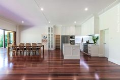 Custom-made kitchen and walk-in pantry. View shows entry to the walk-in pantry and how the Red Mahogany flooring of the extension to the home complements the style of the kitchen. #kitchens www.buildingworksaust.com.ay @buildingworksau