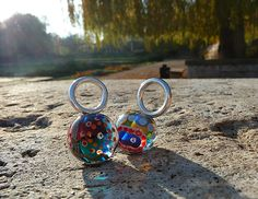 Glass focals, turned into pendants with sterling silver and photographed in Leipzig/Germany. Beads and Photo done by me :)