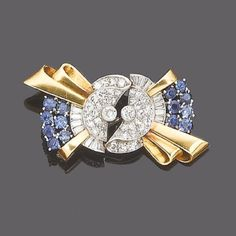A sapphire and diamond double-clip brooch, circa 1940  Each opposing clip designed as a textured scrolling ribbon set throughout with brilliant, baguette and single-cut diamonds, highlighted with circular-cut sapphires, diamonds approx. 1.20ct. total