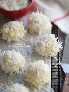 Coconut Snowball Cookies dipped in white chocolate and dunked in coconut. All my favorite flavors! #Snowball