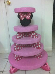 SweetnessBakeshop's  - Minnie Mouse Cupcake Tower @Lauren Phillips   I think it's made out of styrofoam
