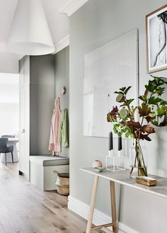 The norsuHOME - Hallway Photographer: Lisa Cohen Stylist: Beck Simon  Paint: Dulux Tranquil Retreat, Dulux Flodded Gum Flooring: Godfrey Hirst  Cabinetry: kaboodle Kitchens  Products: Louis Poulson Above Pendant Cote Salt Print GlobeWest Console, By Lassen Candle Holder, Love Warriors Withering print, Olli Ella Belly Basket (all available at www.norsu.com.au)