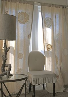 Doilies fused to linen drapes, driftwood lamp, ruffly skirted chair...sigh... Wonderful!!