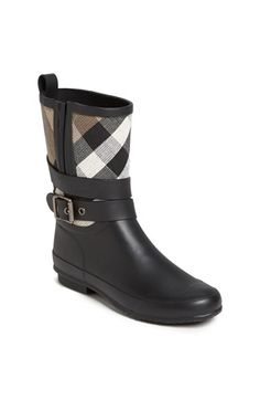Free shipping and returns on Burberry 'Holloway' Rain Boot (Women) at Nordstrom.com. Signature checks style the mid-height shaft of a weather-ready rubber rain boot accented with a decorative buckle strap.