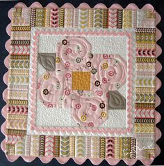 Bloomin'Blossoms table topper from Deonn at Sew We Quilt . . . Print Friendly PDF version available, also.