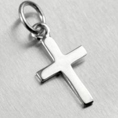 Une croix en argent pleine de sobriété. Symbole de la croix du Christ, elle fera un cadeau parfait de baptême, communion ou profession de foi.    Silvershop vous offre la livraison dès 69.99 euros d'achats: http://www.silvershop.fr/bijoux-argent-collier-pendentif-homme-femme/821-bijou-argent-croix-communion-0200000135430.html