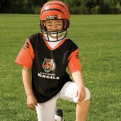NFL® Deluxe Uniform Set - Cincinnati Bengals - Your little football fan can look like a real gridiron warrior wearing this official NFL® uniform set! Included is an official home team jersey, team helmet with authentic logo and team colors and team pants that will have them looking ready to take the field. The set also includes iron-on numbers (0-9) for the back of the jersey. Makes a great Halloween costume! - See more at: http://franklinsports.com/shop/nfl-deluxe-uniform-set