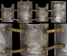 Indian 18th century char-aina (chahar-aina, chahar a'ineh), the borders with traces of gold decoration consisting of undulating and scrolling floral motifs with leather strap attachments. Plate body armor worn over a zirah (shirt of mail) in Persia, India and Central Asia. The two plates worn on the breast and back are considerably larger than those worn at the sides which had recesses for the arms. Chahar aina cuirasses were introduced in Iran in the 16th century.