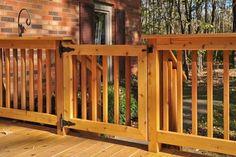Latched Cedar Deck Gate in Marengo built by Rock Solid Builders, Inc.