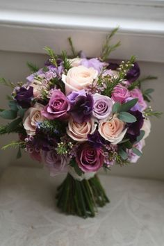 A wedding bouquet of mauve blush and purple silk flowers, bridal bouquets, spring weddings, outdoor wedding ideas, fall weddings #weddingbouquets #purpleweddings