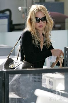 Rachel Zoe goes through security at LAX airport for flight.