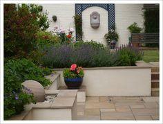 plants ... low platform for a big pot ... garden bench