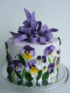 Pansy cake; maybe for an engagement party?  Think we could pull this off with fondont @Sommer Pearson?