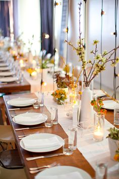 A modern tablescape with vertical string lights.