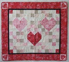 Mosaic Hearts Quilt tutorial by Beth Lancaster from Moonlight Quilts. This valentine quilt pattern includes three heart quilt block patterns surrounded by a background of scrap squares and a bold border with a heart at each corner.