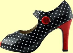 """This black and white polka dot shoe has sexy red accents! The open-toe shoe fastens with Velcro and has the signature """"BP"""" faux button. It has a 1/2 inch hidden platform and a 4"""" heel."""