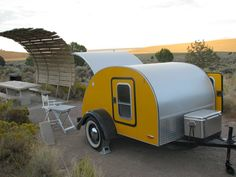 """Teardrop trailer, has just enough space for two people to sleep plus a """"hatchback"""" kitchenette."""