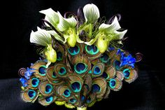 gorgeous peacock flower arrangement