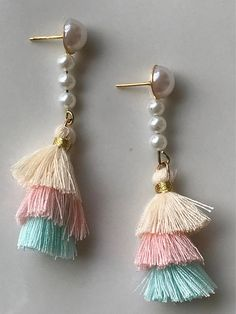 These are faux pearl accented, layered mini tassel earrings in pastel shades of green, pink, and white. They are very lightweight and a hypoallergenic post. These are fun and colorful statement earrings that will match a variety of outfits. Please see my other listings for all available