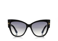 Tom Ford Wide cat-eye acetate style sunglasses with metal 'T' temple decoration. (=)