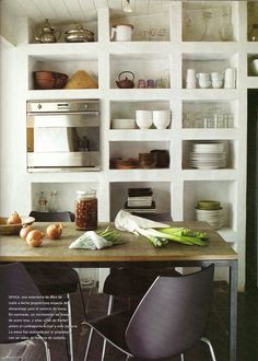 Kitchen - Open concept shelving for appliances, dinner ware, art objects, etc.  Perfect for a casual style of living.