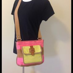 "Fossil canvas cross body bag. Great looking cross body bag in spring colors. Canvas with wide adjustable strap. Measures 10"" x 10.5"" strap is 44"" fully extended. Navy blue lining. Has inside zippered pocket , front pocket has snap closure. Fossil Bags Crossbody Bags"