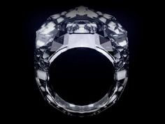 """World's first (and most expensive!) """"All Diamond"""" ring. ($70,000,000) No metal setting. Carved entirely from a single (150+ carat) flawless diamond!"""