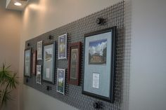 Close up of an art feature - in this case, company awards are sandwiched in between stained mdf and plexiglass and mounted to heavy duty metal screens
