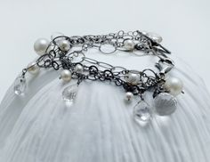 www.calliope-jewelry.com Oxidized sterling silver with pearls and quartz.