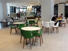 Enea's #Lottus Wood chairs in green and white polypropilene shell in the new Central Park Mall in Sydney (Australia).